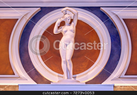 Nude Classical Female Statue stock photo, Single nude classical female statue combing her hair by Kevin Tietz