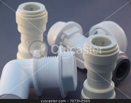 Plastic plumbing joints stock photo,  by Stephen Rothwell