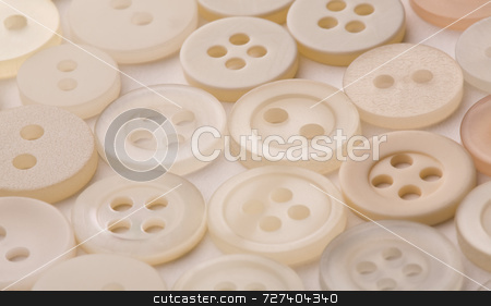 4818ecccef990 stock photo, White sew-through buttons laid out in soft light by Jon Stokes