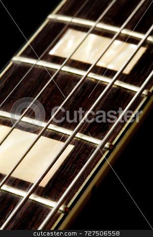 An electric guitar fretboard stock photo, An electric guitar fretboard and strings by Jon Stokes
