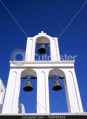 Three bells stock photo, Three church bells on a greek bell tower by Paul Phillips