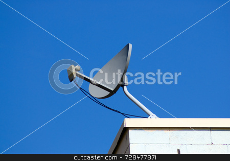 Satellite stock photo, A home television satellite shot against a cloudless blue sky by Richard Nelson