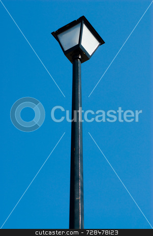 Lamp Post stock photo, Outside lamp post isolated against a blue background by Richard Nelson