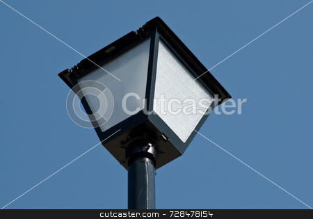 Close-up Lamp Post stock photo, Close up view of a lamp post shot against a cloudless blue sky by Richard Nelson