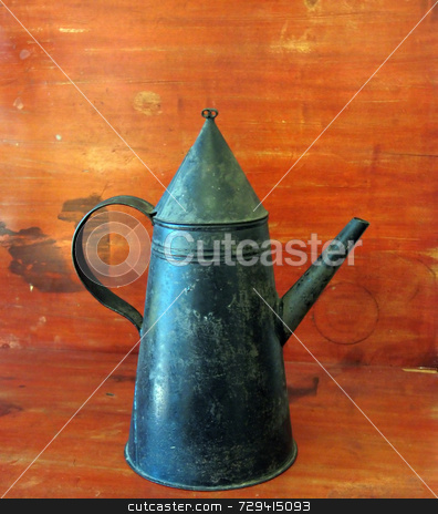 Early Tin Teapot stock photo, an early tole tin teapot,  on an antique table by Tom and Beth Pulsipher