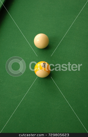 Nine ball stock photo, A game of pool with a shot lined up by Tim Markley