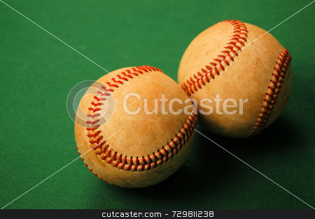 Two baseballs stock photo, Two worn out old baseballs after a season of use by Tim Markley