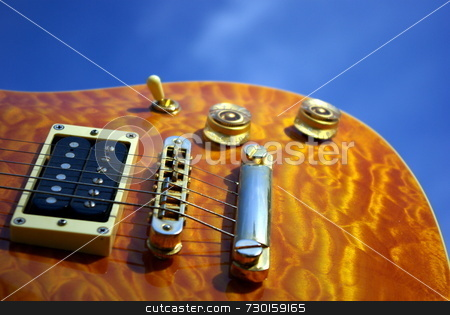 Pillow maple guitar stock photo, A pillow maple guitar body against a blue sky by Lynn Bendickson