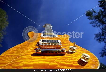 Pillow maple guitar stock photo, A pillow maple guitar body against a blue sky by Lynn Bendickson