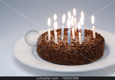 Chocolate Birthday Cake  stock photo, Chocolate Birthday Cake with lit candles on a white plate by Jon Stokes