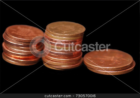 Pennies stock photo, Piles of 1 pence and 2 pence pieces by Philippa Willitts