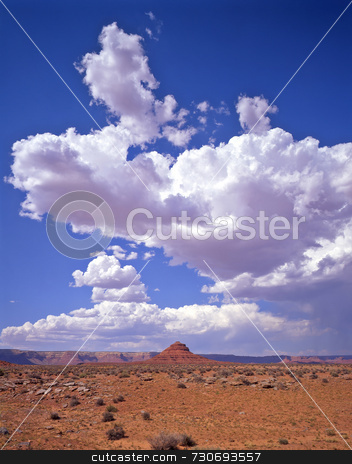 Clouds & Valley of Gods stock photo, Clouds above the Valley of the Gods in Utah. by Mike Norton