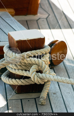 Mooring rope stock photo, Detail of a moored dock by Massimiliano Leban