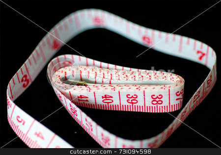 Tape Measure stock photo, Red and white measuring tape, with numbers. by Philippa Willitts
