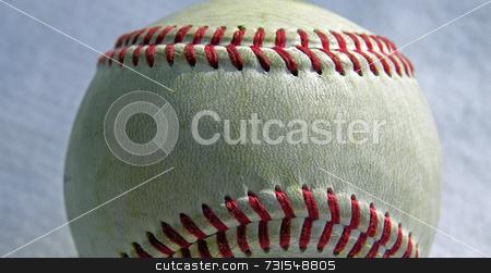 Baseball stock photo, Baseball up close against a blue background by Tim Markley