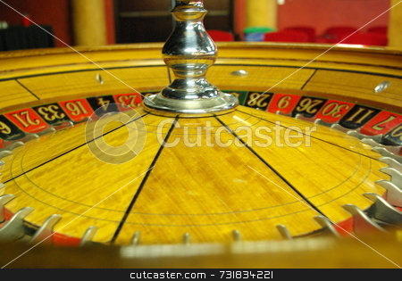 Roulette Wheel stock photo, An old Roulette wheel with a silver center by Lynn Bendickson