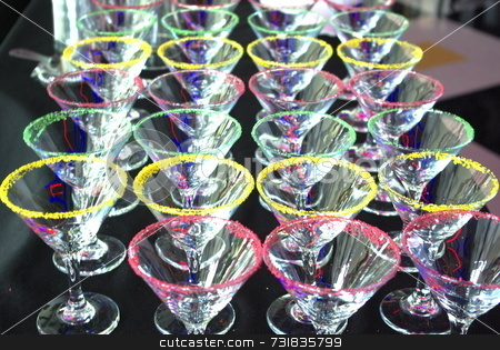Martini cocktail glasses stock photo, Colorful green, red and yellow Martini cocktail glasses by Lynn Bendickson