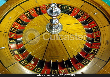 Old Roulette wheel  stock photo, An old Roulette wheel with a silver center by Lynn Bendickson