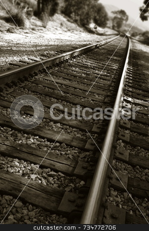 Railroad Tracks stock photo, Railroad tracks shown in a different perspective in black and white by Henrik Lehnerer
