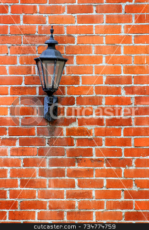 Brick Wall Light stock photo, Old street light on a red brick wall. by Henrik Lehnerer