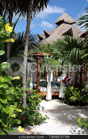 Tropical Paradise stock photo, A poolside sun shelter surronded by palm vegetation at a tropical resort. by Chris Hill