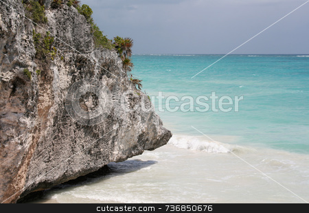 Jagged Cliff Turquoise Sea stock photo, The rocky beach jagged, but beautiful turquoise sea of Tulum in Mexico. by Chris Hill