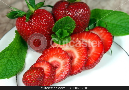 Sliced Fresh Strawberries stock photo, Fresh whole and sliced Strawberries on a white plate. by Lynn Bendickson