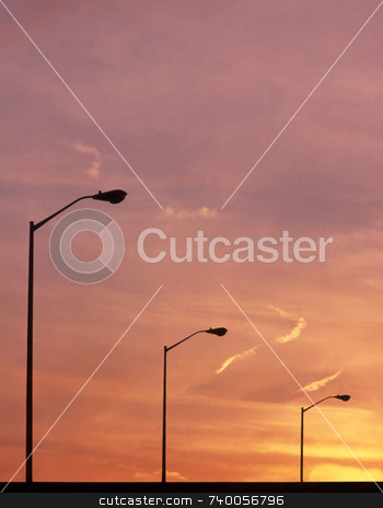 Street Lights stock photo, Street lights at sunset. by Kathy Piper
