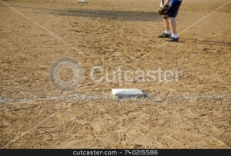 Baseball Base and Infield Dirt and First Baseman XL stock photo, Baseball base - the objective is to get there safely - this field has been used a lot and there are shoeprints everywhere. by Mitch Aunger