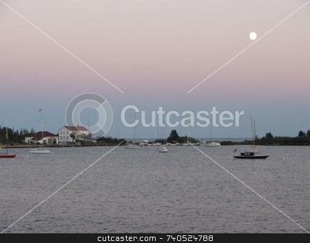 Moon Over Grand Marais stock photo, An August moon hangs over the Grand Marais, Minnesota harbor. by Dennis Thomsen