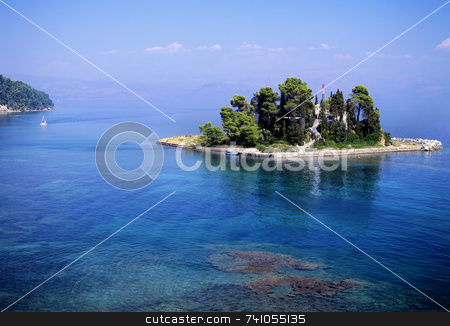 Blue day stock photo, A small island off the coast of Corfu town, greece by Paul Phillips