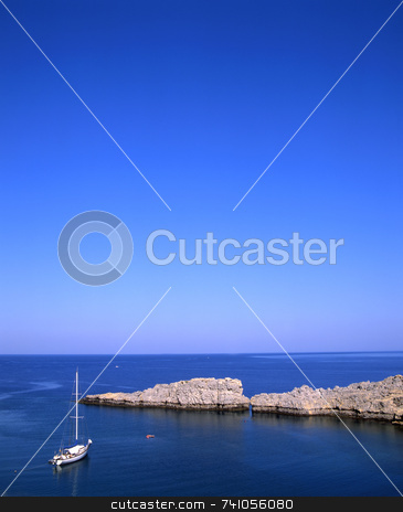 Lindos bay stock photo, Sailboat moored off the coast of the village of Lindos on the greek island of Rhodes by Paul Phillips