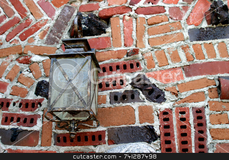 Brick Light stock photo, Old street light on a interesting brick wall. by Henrik Lehnerer