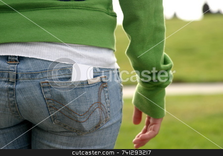 Butt stock photo, Butt of a young girl with grass in the background. by Henrik Lehnerer