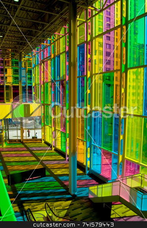 Colorful hall stock photo, Hall of a convention center lit by sunlight passing through tinted windows by Jean Larue-Frechette