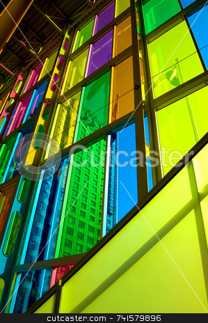 City behind colorful windows stock photo, Colorful tinted windows in a convention center by Jean Larue-Frechette