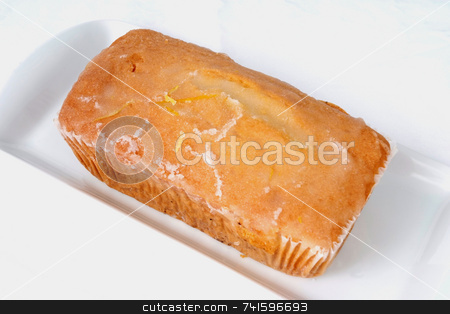 Pound Cake stock photo, Mass-produced catering trade cake on a white background by Paul Phillips