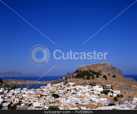 Lindos stock photo, View looking over the town of Lindos, Rhodes, Greece with the castle in the background. by Paul Phillips