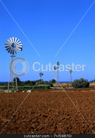 Irrigation stock photo, Irrigation windmills pumping water for farmland in Cyprus by Paul Phillips