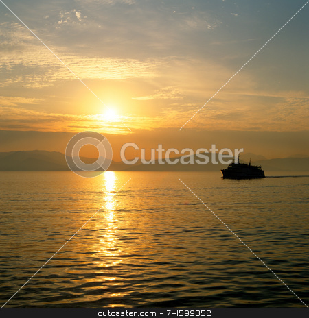 Sun Rise stock photo, Sun rising over the greek island of Corfu greece by Paul Phillips