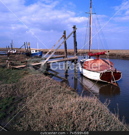 Fenland stock photo, Boats moored on the Lincolnshire fens by Paul Phillips