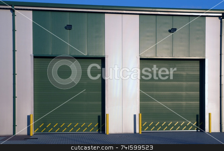Closed stock photo, Two large doors of a modern industrial unit by Paul Phillips