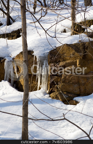 Icy rock stock photo, Icicle on a big snow covered rock by Jean Larue-Frechette