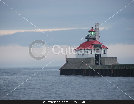 Duluth Harbor Lighthouse stock photo, The canal entry to the Duluth, Minnesota harbor on Lake Superior is guarded by two lighthouses.  The lighthouse pictured here is a popular tourist site in Canal Park. by Dennis Thomsen