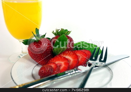 Berries And Juice stock photo, Sliced strawberries and orange juice on a white background by Lynn Bendickson