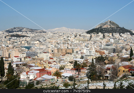 Athens in Winter stock photo, A view of an area of Athens, Greece (Plaka area close to the camera, Lycabettus Hill far right) after a snowfall by Georgios Alexandris