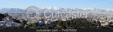 Athens Winter Panoramic stock photo, A panoramic of the western part of Athens and the nearby snow-blanketed mountains from the hill of the Acropolis, after a winter snowstorm by Georgios Alexandris
