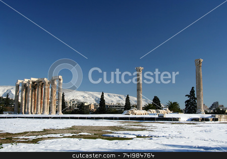 Olympius Zeus Temple in Winter stock photo, The ancient temple of Olympian Zeus in Athens, Greece, after a snowfall by Georgios Alexandris
