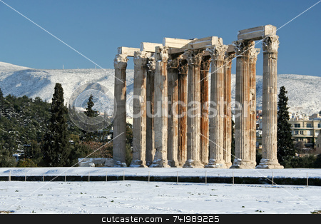 Winter Zeus Olympius Temple stock photo, The ancient temple of Olympian Zeus in Athens, Greece, after a snowfall by Georgios Alexandris