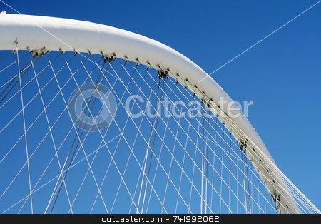 Curved Construction Detail stock photo, A curved suspension supporting a construction with metallic cords by Georgios Alexandris